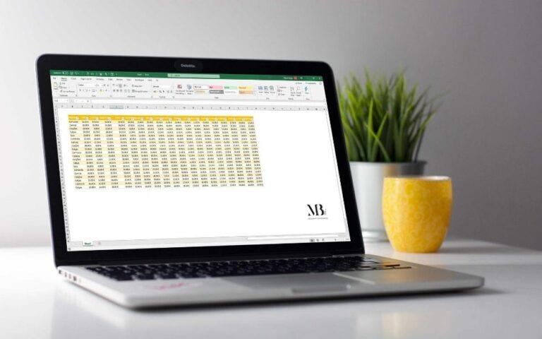 Secretária com um computador com uma folha de Excel aberta e os dados formatados como tabela, com um vaso e um copo
